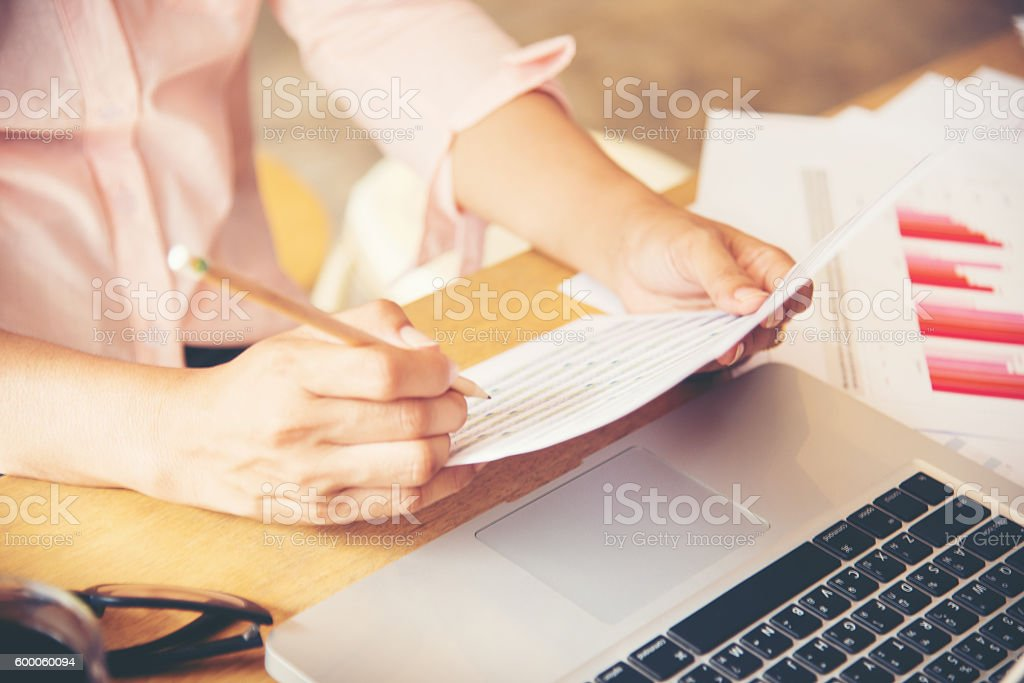 Business woman working at her desk. stock photo