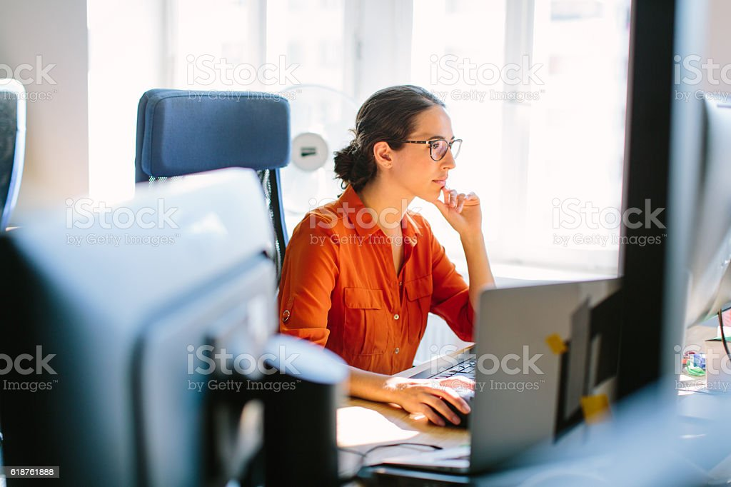 Business woman working at her desk stock photo