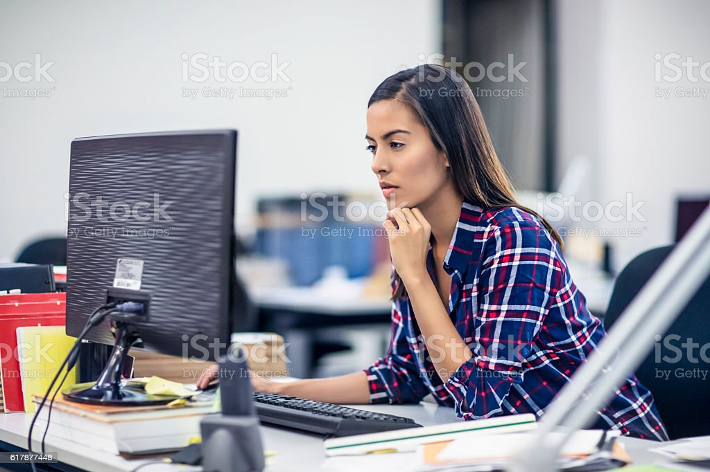 Business woman working at her office desk stock photo