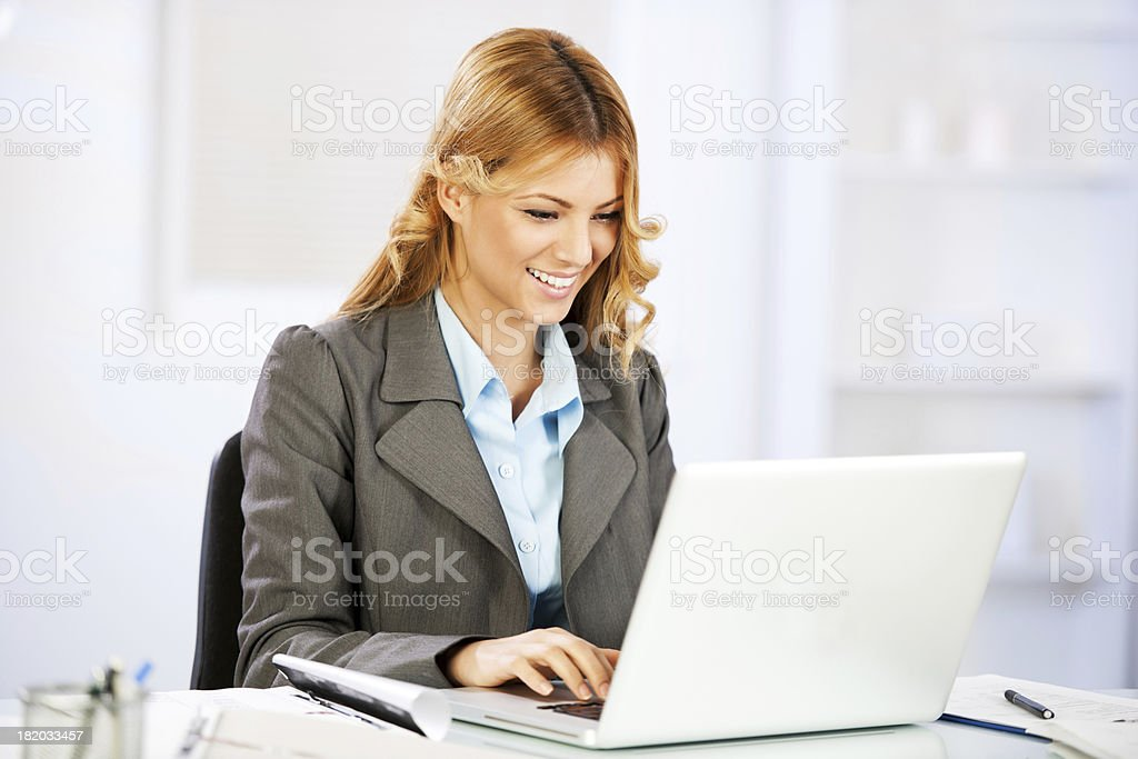Business woman working at laptop. royalty-free stock photo