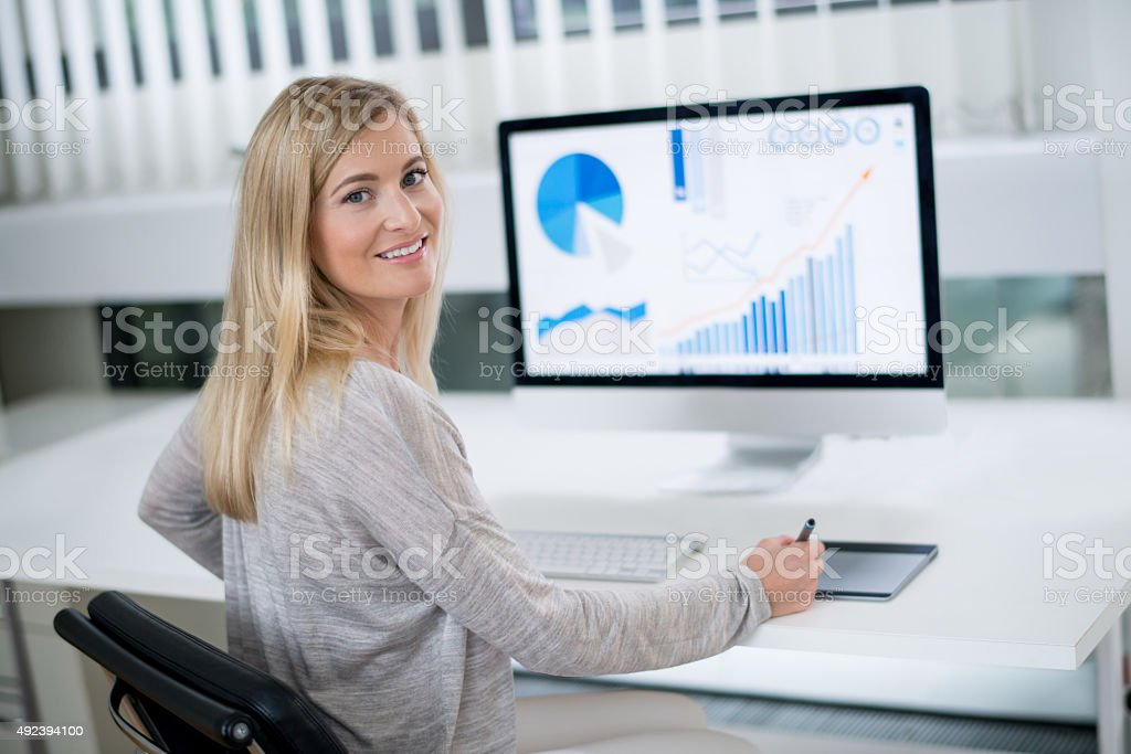 Business woman working at the office stock photo