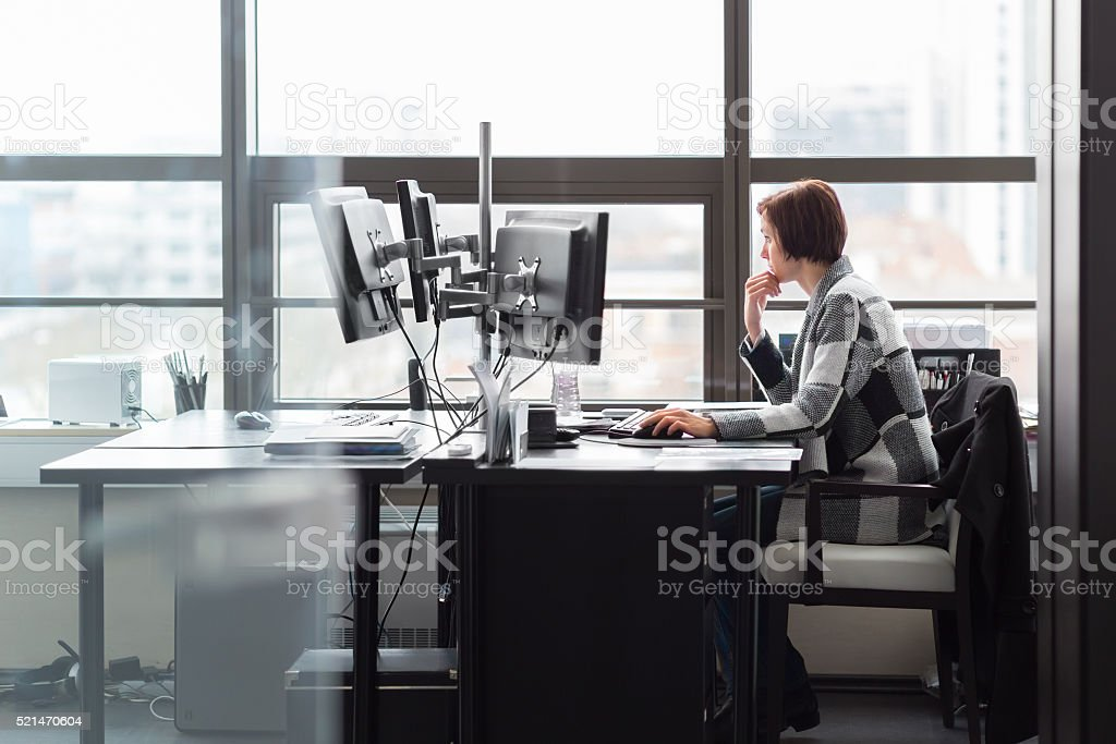 Business woman working in corporate office. stock photo
