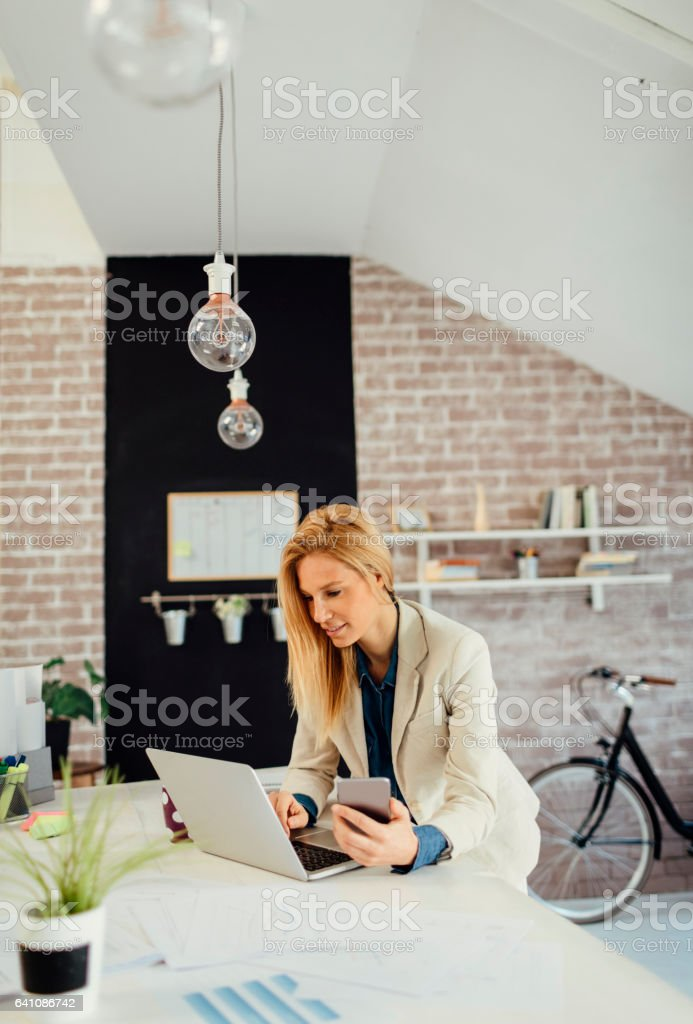 Business woman working in her office stock photo