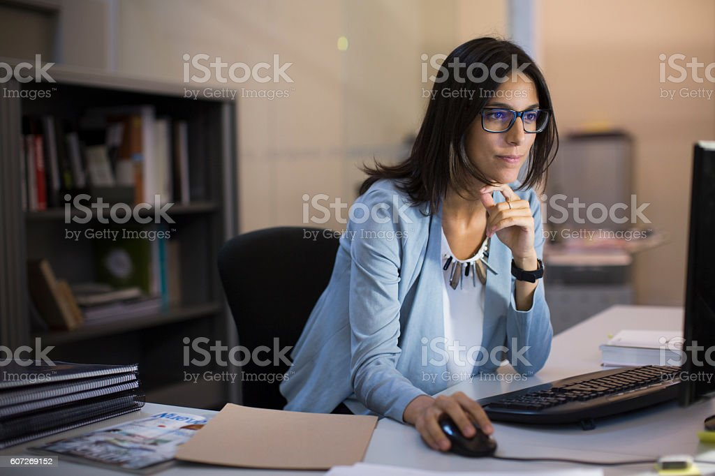 Business woman working late hours. stock photo