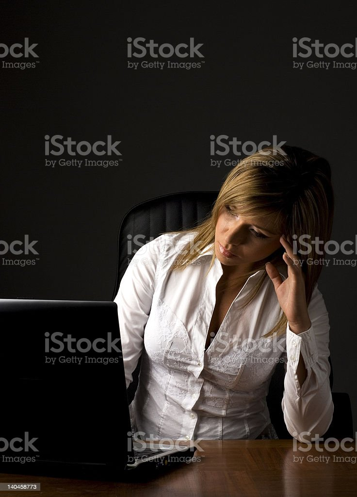 Business woman working lately royalty-free stock photo