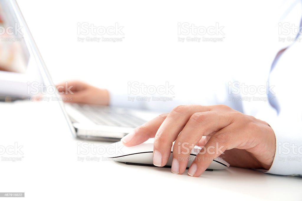 A business woman working on a laptop stock photo