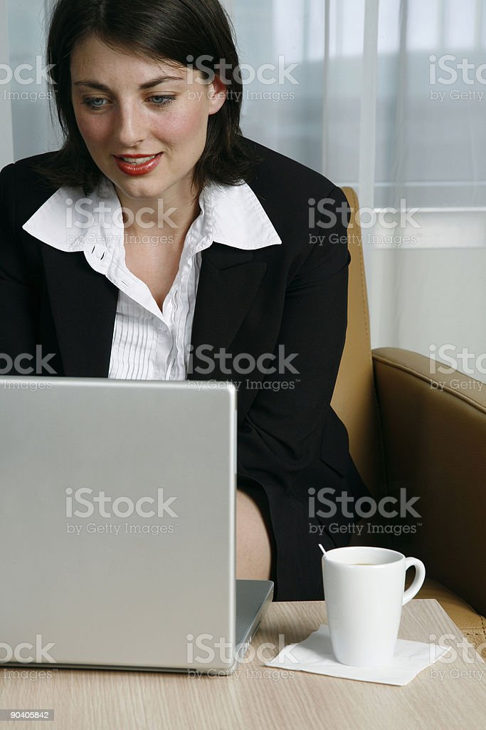 Business woman working on a laptop royalty-free stock photo