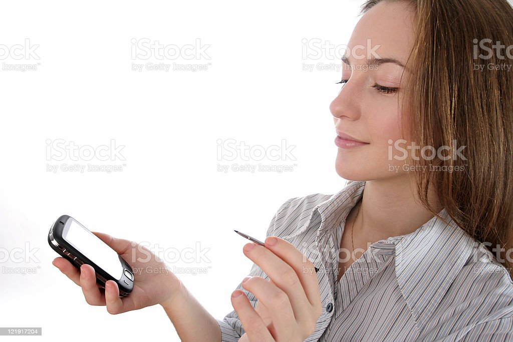 Business woman working on a pda organizer royalty-free stock photo
