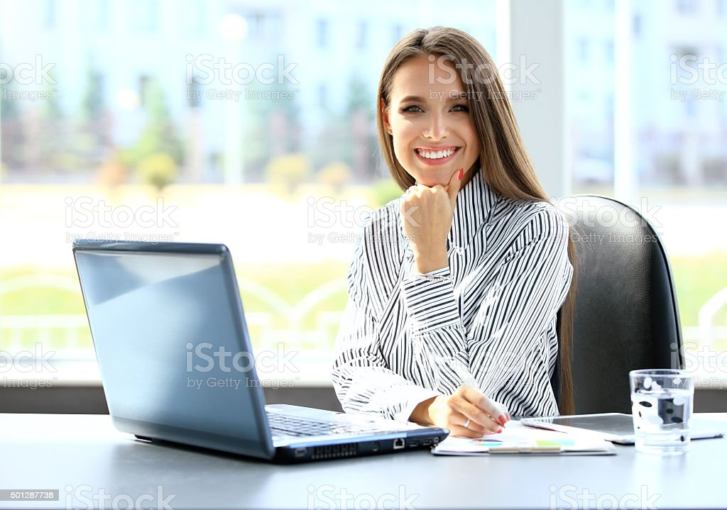 Business woman working on laptop computer stock photo