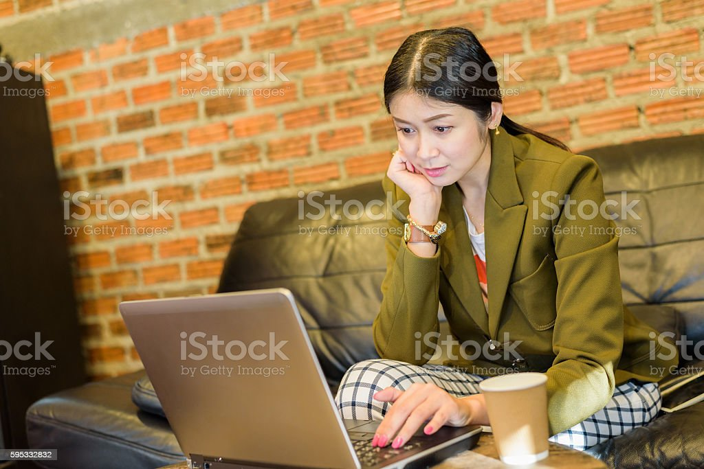 Business woman Working on Laptop in Coffee Shop stock photo