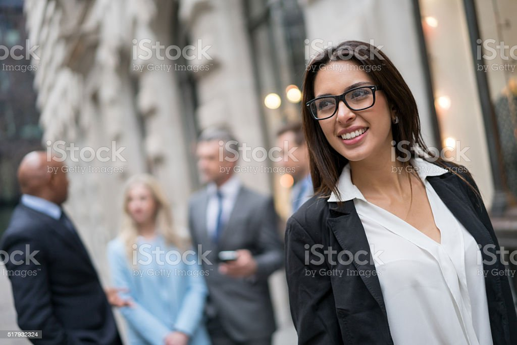 Business woman working with a group stock photo
