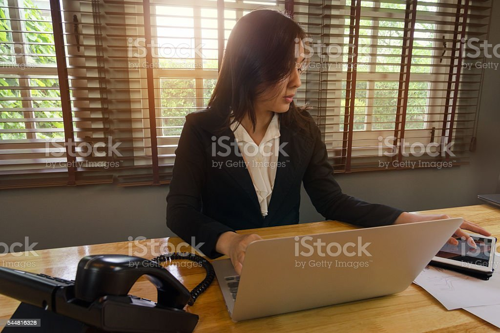 Business woman working with laptopand tablet in office stock photo