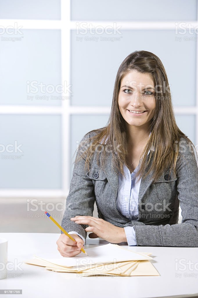 Business Woman Writing notes at desk stock photo
