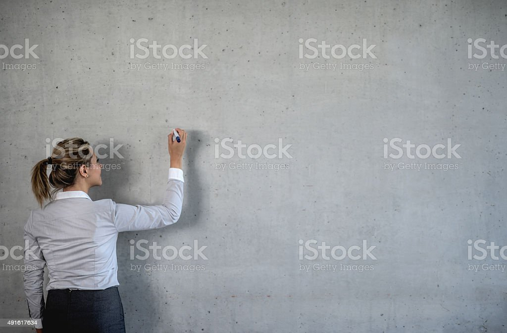 Business woman writing on a board stock photo