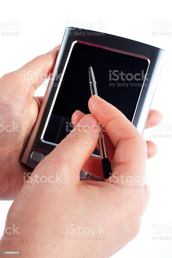 Business woman writing on a pda royalty-free stock photo