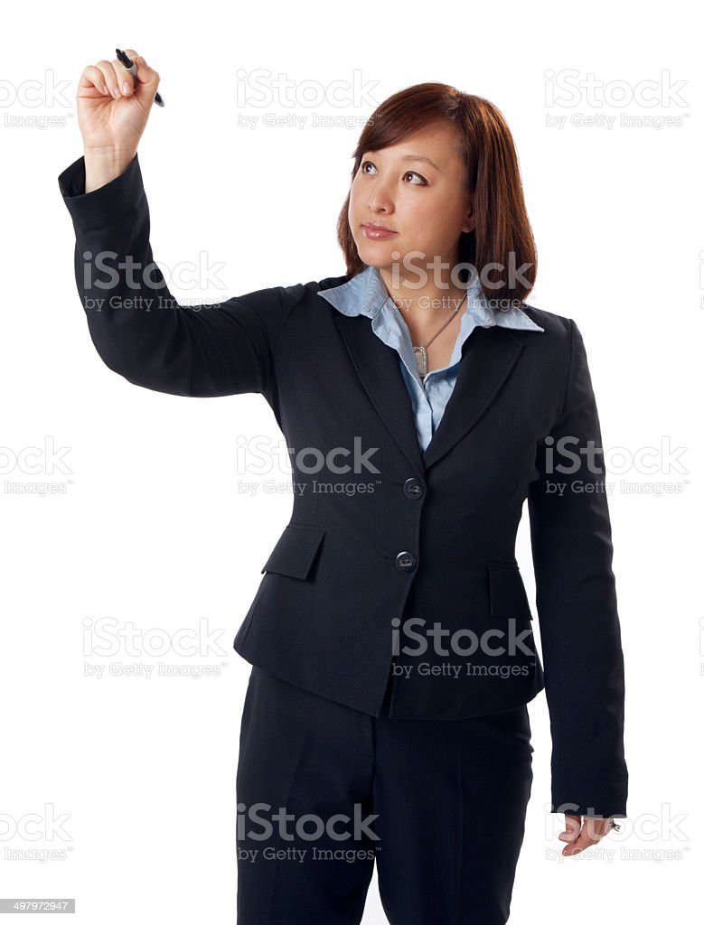 Business Woman Writing on a White Board stock photo