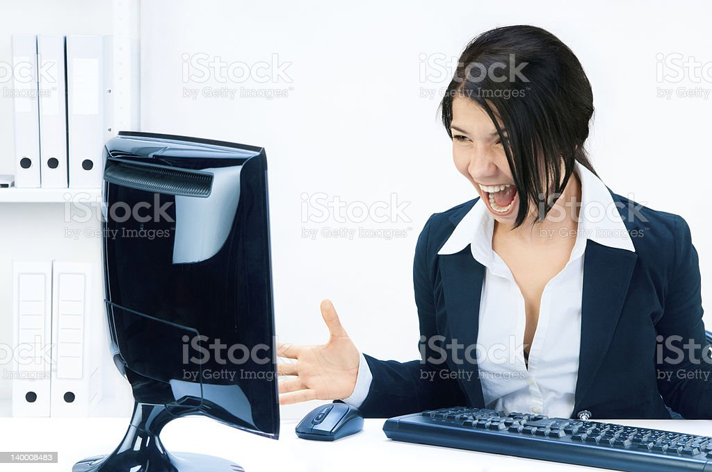 Business woman yelling at the monitor. royalty-free stock photo