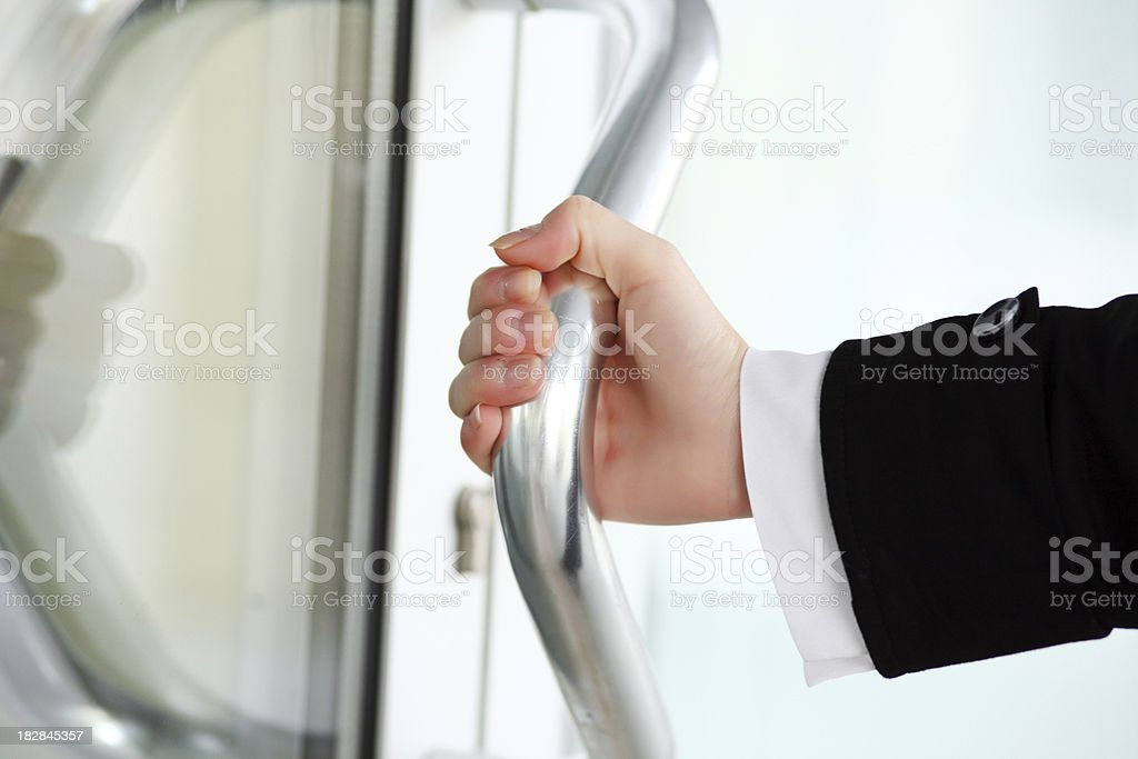 Business woman's hand opening a door. royalty-free stock photo