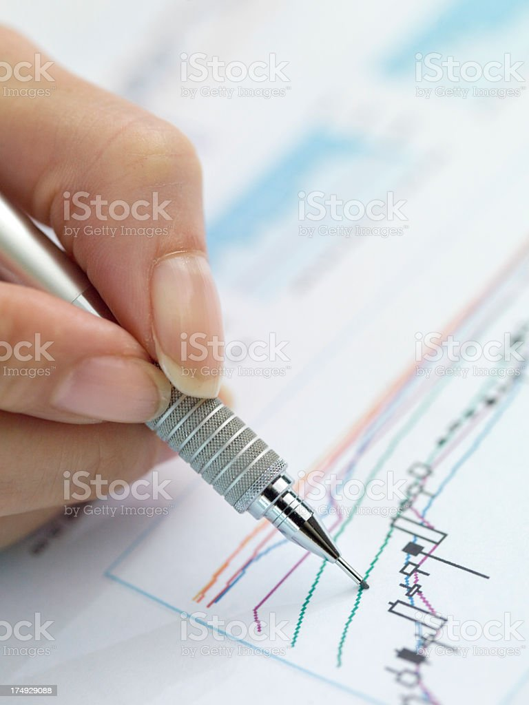 Business woman's hand tracing the graph. royalty-free stock photo