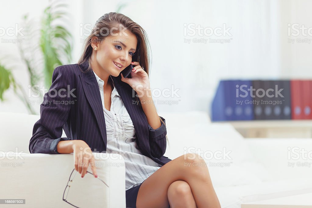 Attractive business woman working in office stock photo