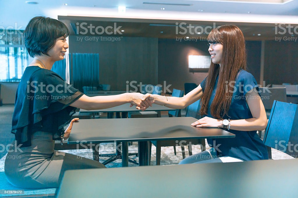 business women agreement stock photo
