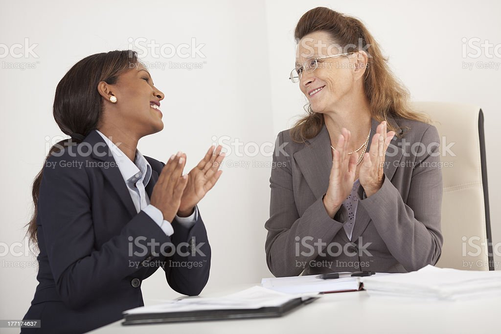 Business women clapping hands. royalty-free stock photo