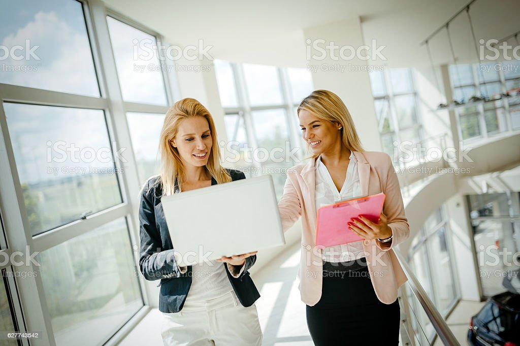 Business women colleagues at work stock photo