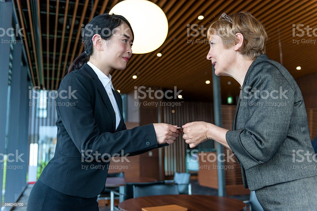 Business women exchanged business cards, Kyoto, Japan stock photo