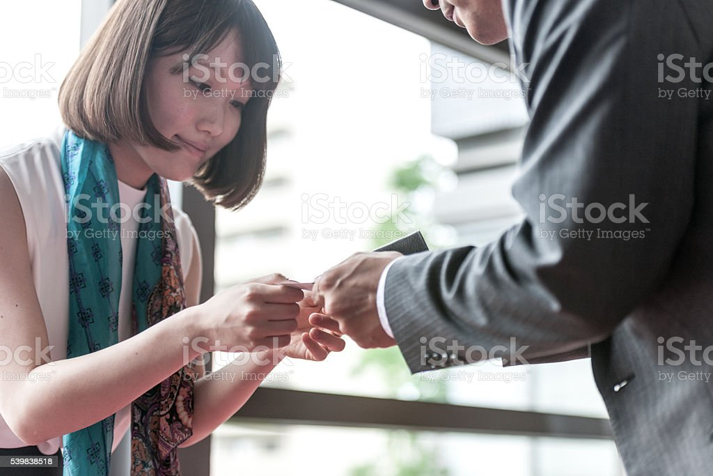 Business women exchanged business cards,Kyoto,Japan stock photo