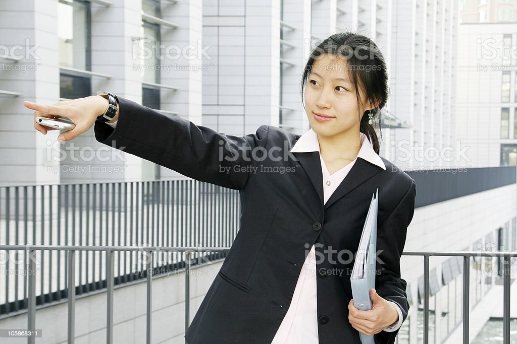 business women holding a folder  and mobile phone royalty-free stock photo