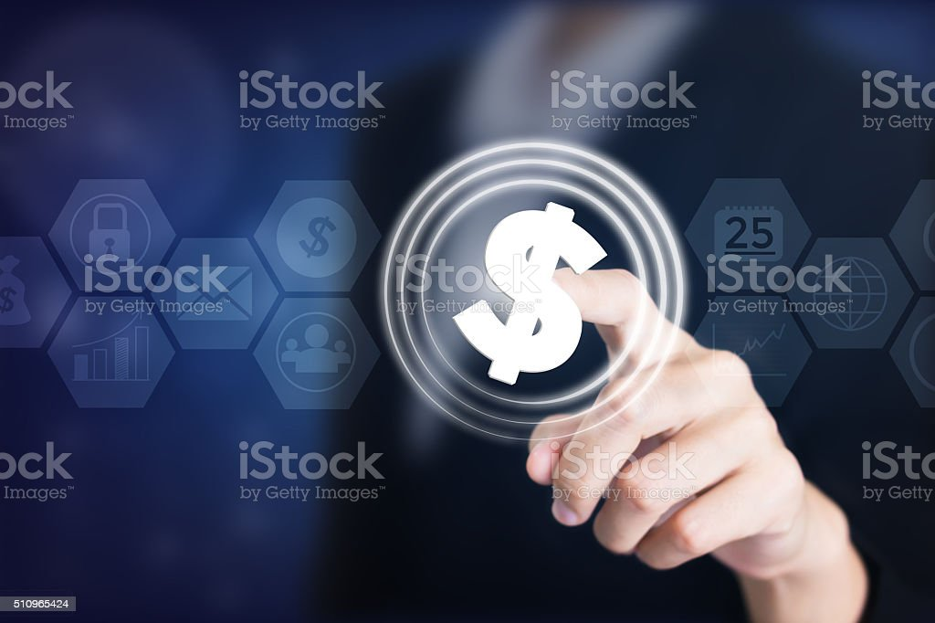 Business women holding posts in dollar signs ($). stock photo