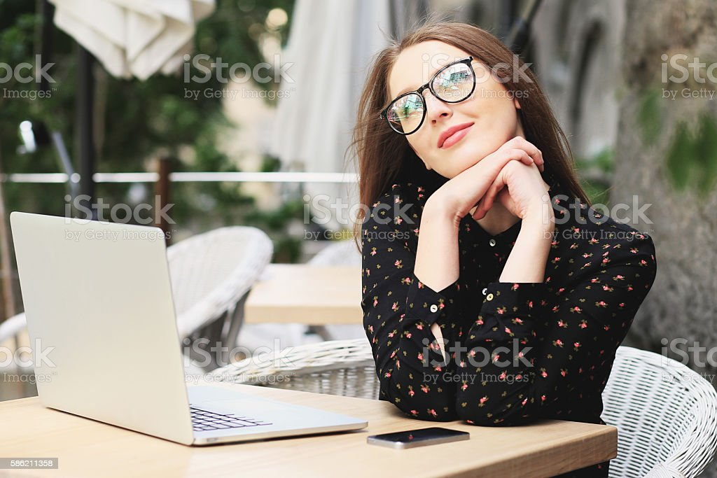 Business women is wearing glasses black shirt in the cafe stock photo