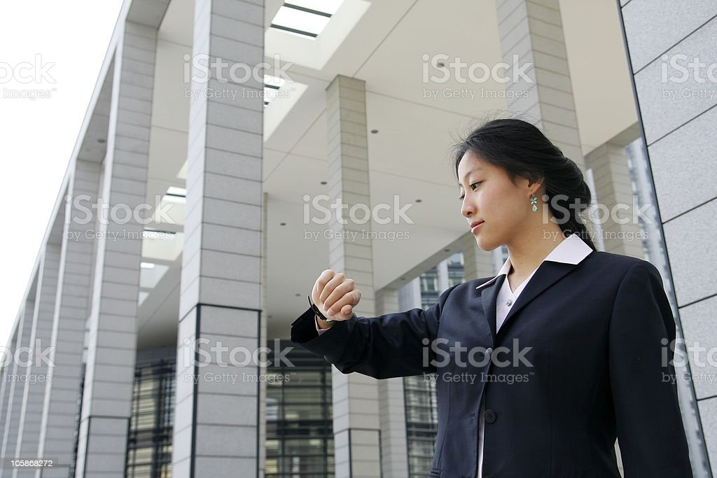 business women look at her watch royalty-free stock photo