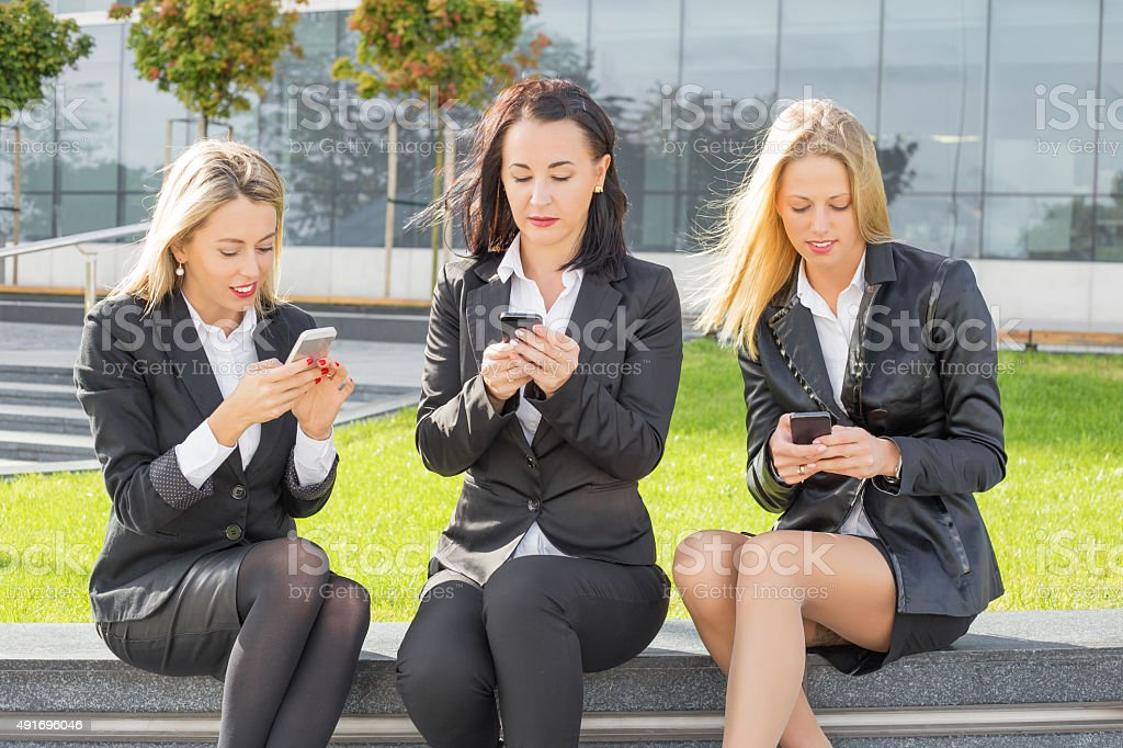 Business women on their cellphones stock photo