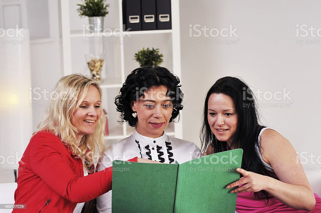Business women reading a report royalty-free stock photo