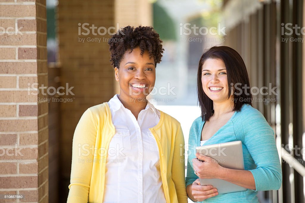Business women standing outside an office building. stock photo
