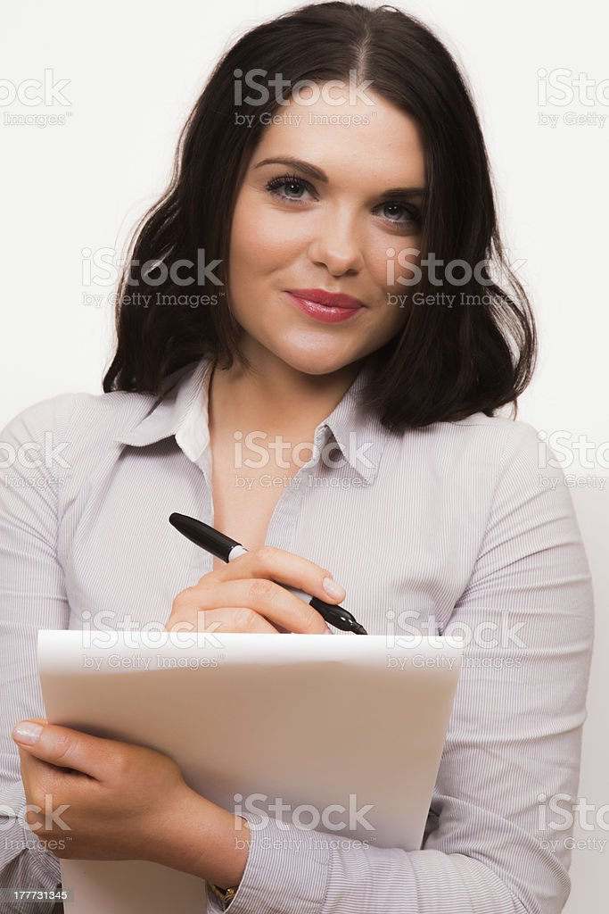 Business women taking notes on a pad with pen royalty-free stock photo