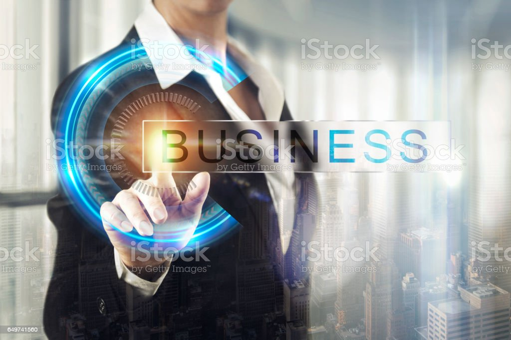 Business women touching the business screen stock photo