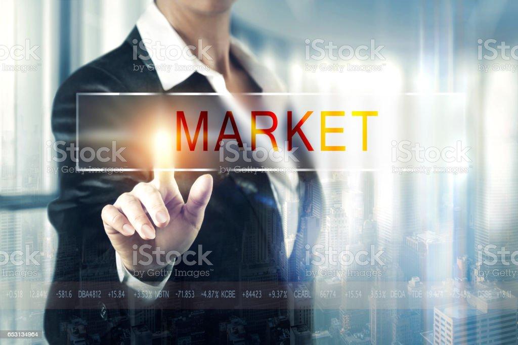 Business women touching the market screen stock photo