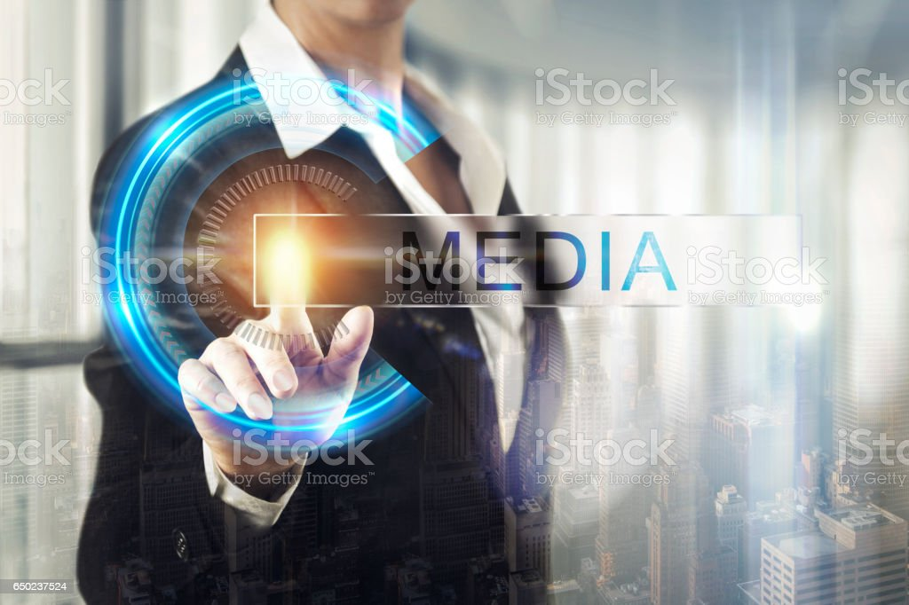 Business women touching the media screen stock photo