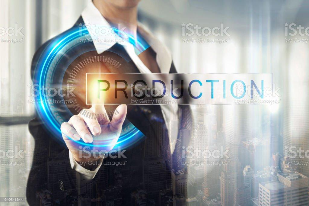 Business women touching the production screen stock photo