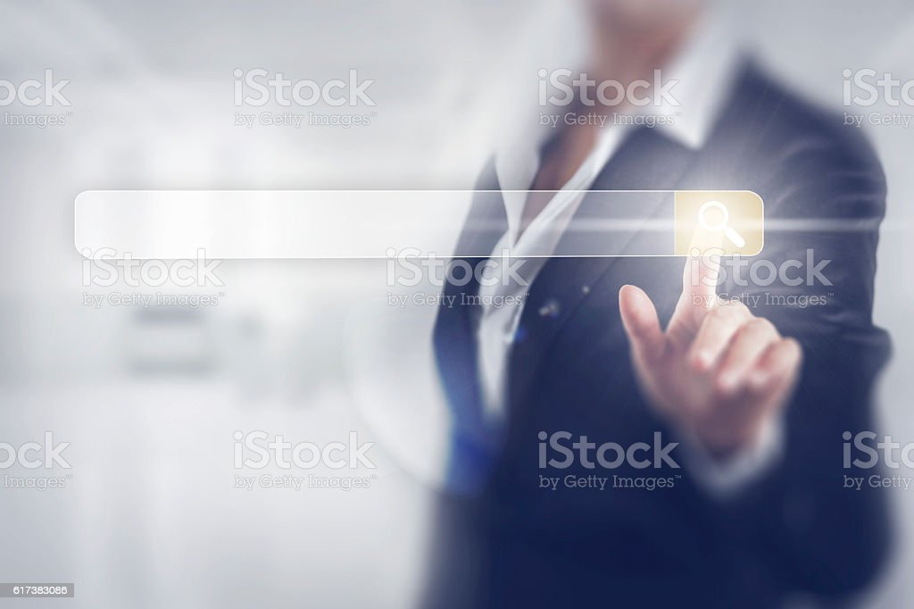 Business women touching the search screen stock photo