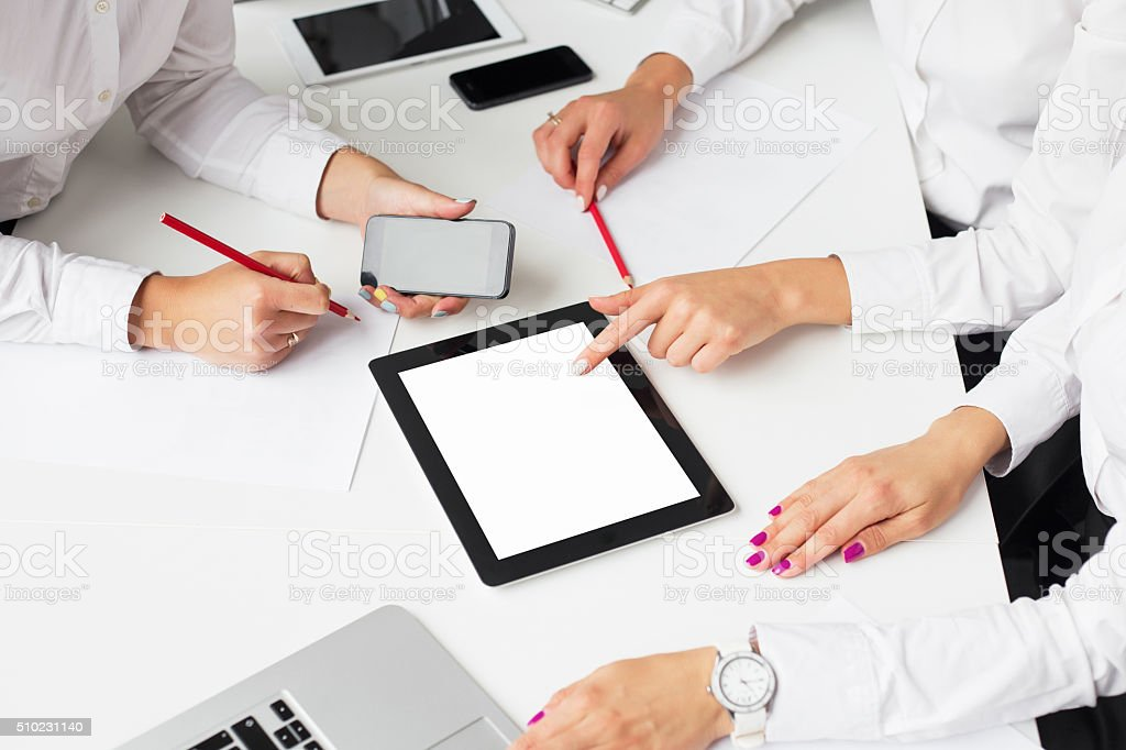 Business women using tablet computer at the meeting stock photo