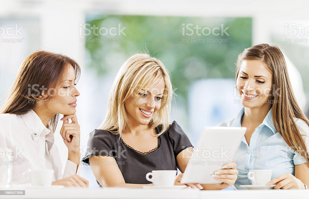 Business women using touchpad outdoors. royalty-free stock photo