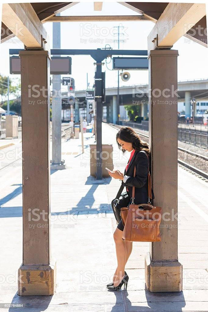 Business Women Waiting At The Train Station stock photo