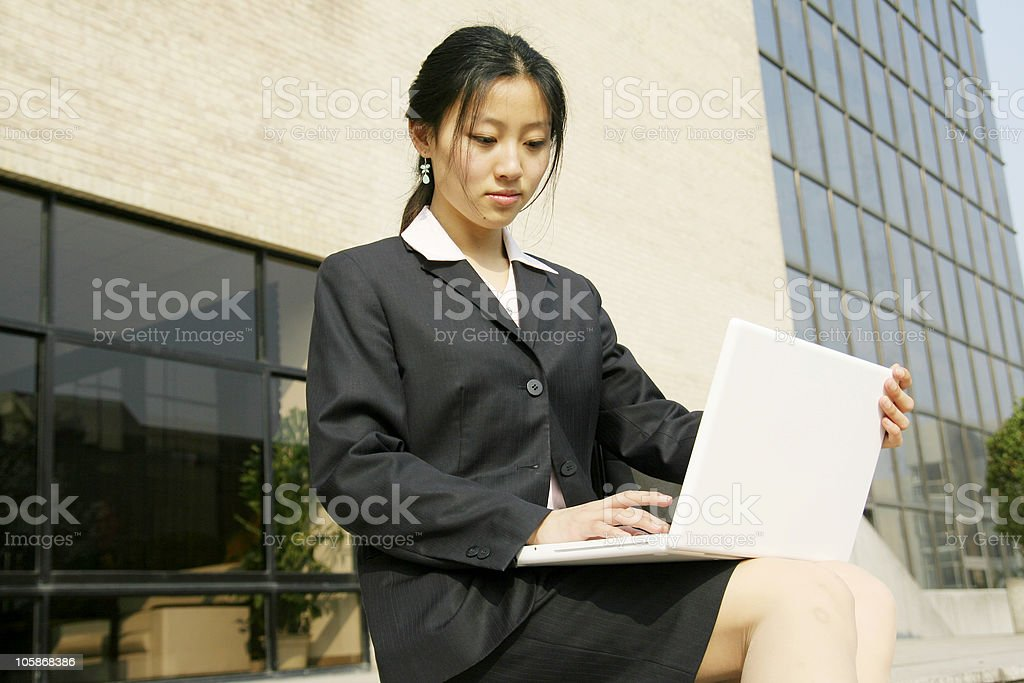 business women working with laptop outside royalty-free stock photo