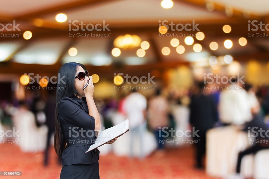 Business women yawn in convention room stock photo