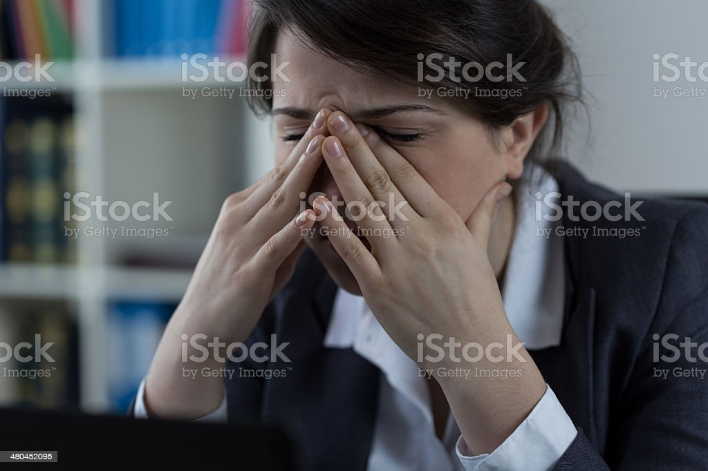 Business worker with sinus pain stock photo