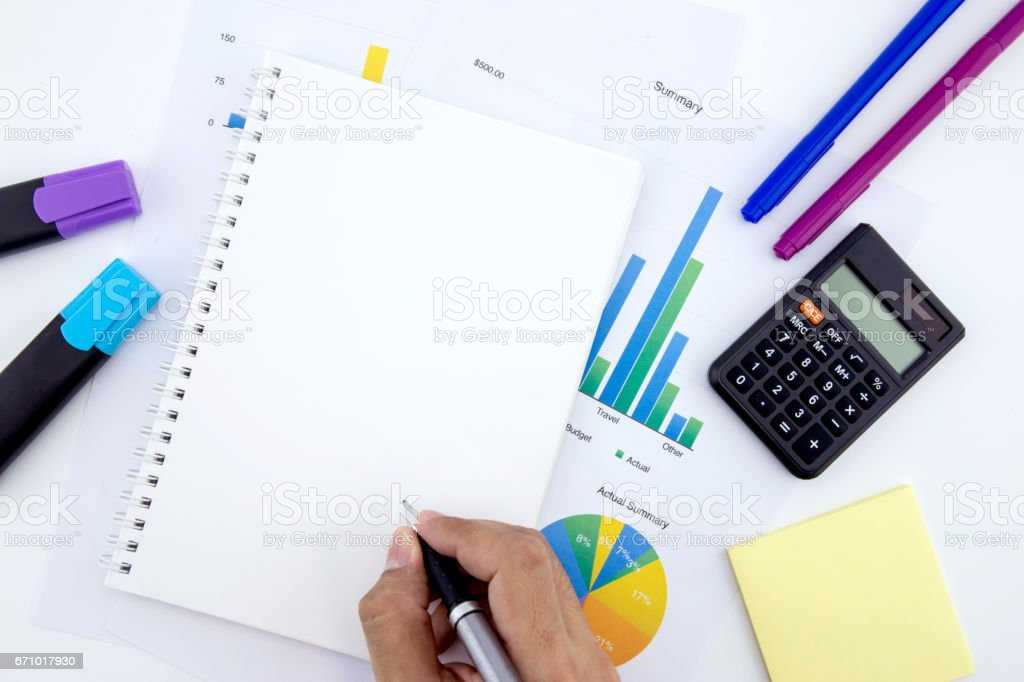 Business workplace papers with graphs and notebook and diagram. stock photo