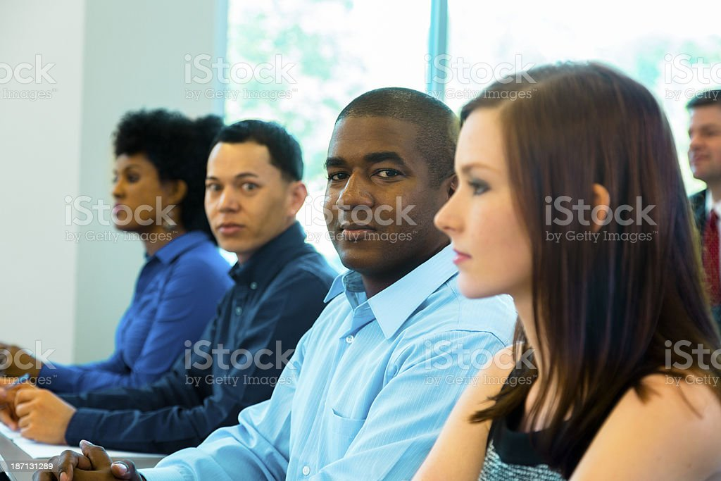 Business:  Young adult professionals attend a seminar. stock photo